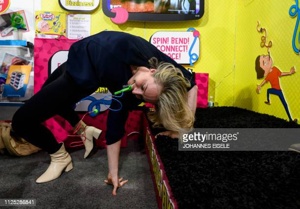 An exhibitor displays Hanks Twisted Challenge at the Wicked Cool Toys booth at the annual New York Toy Fair, at the Jacob K. Javits Convention Center...