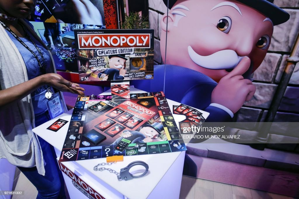 An exhibitor displays the Monopoly 'Cheaters Editon' during the annual New York Toy Fair, on February 20, 2018, in New York. /