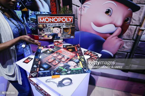 An exhibitor displays the Monopoly 'Cheaters Editon' during the annual New York Toy Fair on February 20 in New York / AFP PHOTO / EDUARDO MUNOZ...