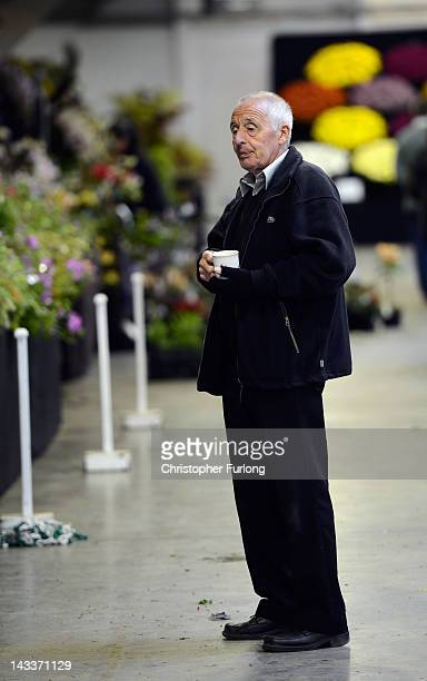 An exhibitor drinks tea and ponders his display as horticulturalists prepare their displays for the Harrogate Flower Show on April 25 2012 in...