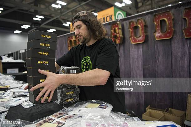 An exhibitor of OrigAudio a division of Forty Four Group LLC unpacks merchandise before the opening of the trade show at the Austin Convention Center...
