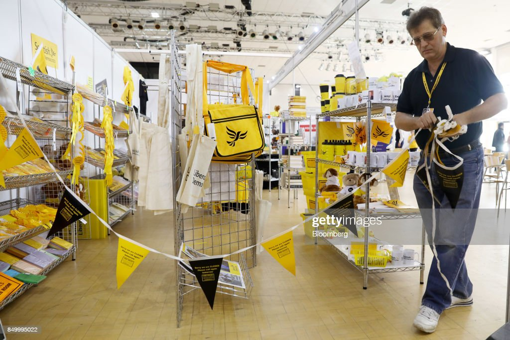 An exhibitor opens his U.K.'s Liberal Democrat Party branded merchandise stand at the party's annual conference in Bournemouth, U.K., on Tuesday, Sept. 19, 2017. Cable said U.K. Prime Minister Theresa May should fire her foreign secretary, Boris Johnson, over an article he published on Saturday about Britains departure from the European Union. Photographer: Luke MacGregor/Bloomberg via Getty Images