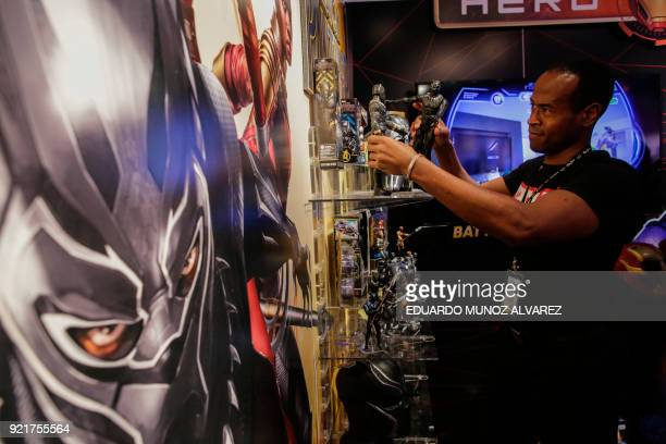 "An exhibitor organizes ""Black Panther"" items at the Hasbro showroom during the annual New York Toy Fair, on February 20 in New York. Panther claws,..."