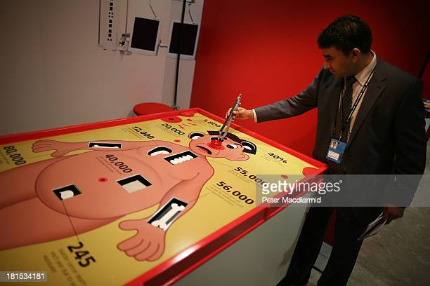 An exhibitor plays a giant version of the Operation game at the Labour Party conference on September 22 2013 in Brighton England The opposition...