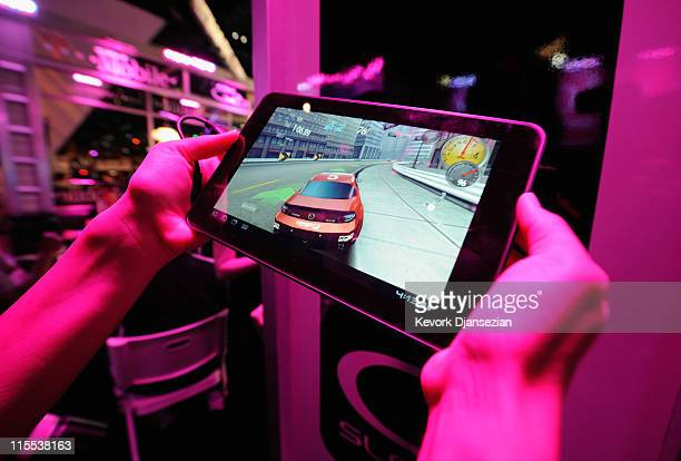 An exhibitor plays a video on the TMobile LG GSlate tablet at the TMobile booth during the Electronic Entertainment Expo on June 7 2011 in Los...