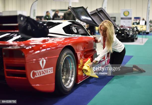 An exhibitor polishes a race car on display at the London Classic Car Show at ExCel on February 23 2017 in London England The London Classic Car Show...