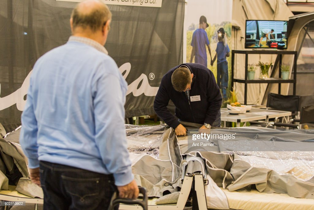 An exhibitor prepares a pop-up trailer tent at the start of the Reise + Camping exhibition on February 21, 2018 in Essen, Germany. The annual event features over 1000 exhibitors from over 20 countries.