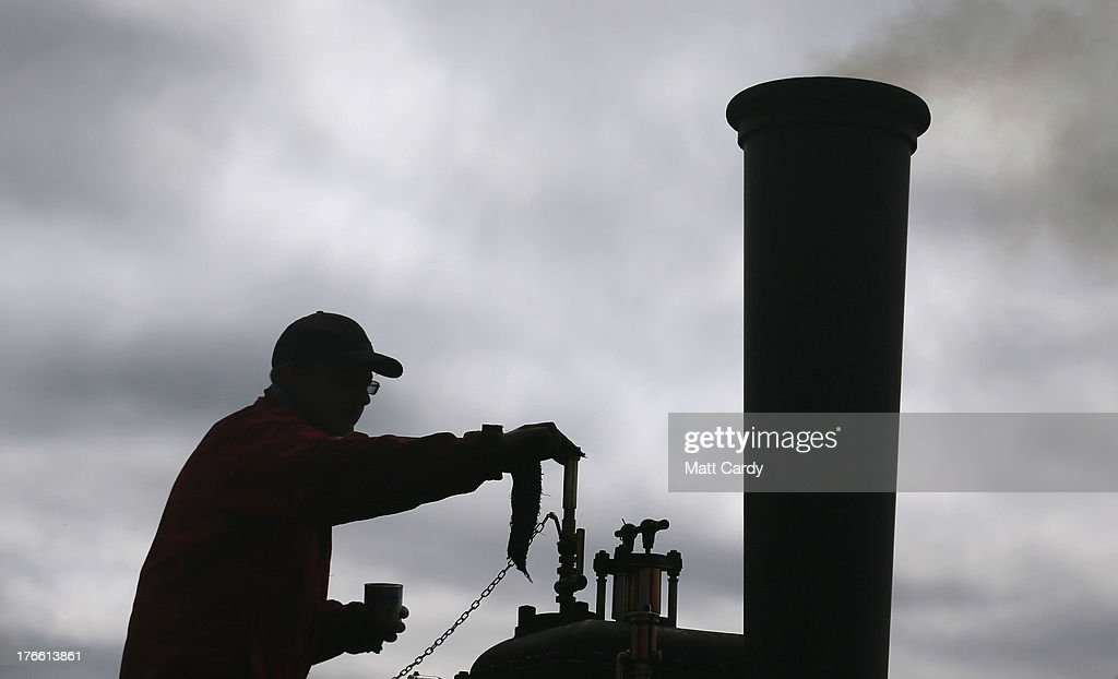 An exhibitor prepares a steam engine to show at the Cornish Steam and Country Fair at the Stithians Showground on August 16, 2013 near Penryn, England. The annual show, now in 58th year, is one of Cornwall's largest outdoor events and one of the UK's most popular and respected steam rallies.