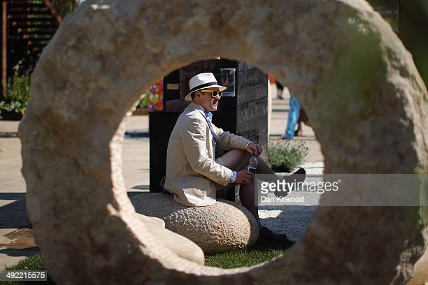 An exhibitor relaxes on his stand at the 2014 Chelsea Flower Show at Royal Hospital Chelsea on May 19 2014 in London England The prestigious...