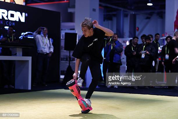 An Exhibitor rides hover board during the 2017 Consumer Electronics Show in Las Vegas Nevada USA on January 08 2017