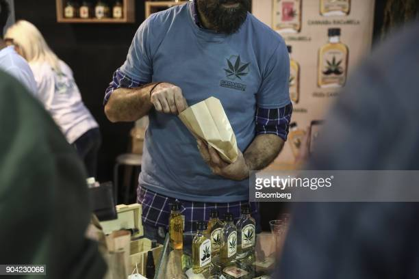 An exhibitor selling bottles of cannabis infused ouzo liquor manufactured by Cannama at the 1st International Cannabis Expo at the Faliro Sports...