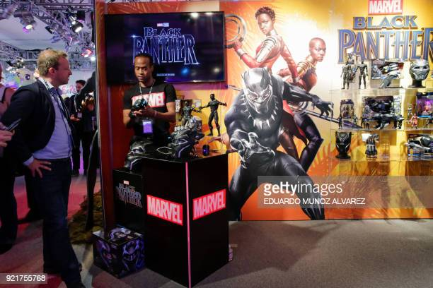 An exhibitor shows 'Black Panther' items to attendees at the Hasbro showroom during the annual New York Toy Fair on February 20 in New York Panther...
