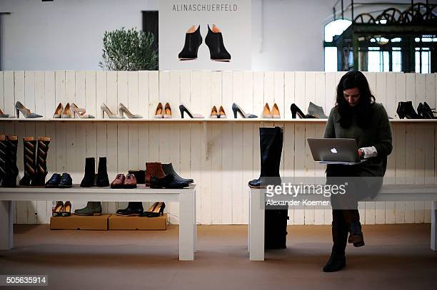 An exhibitor sits at the Greenshowroom trade show during the MercedesBenz Fashion Week Berlin Autumn/Winter 2016 at Postbahnhof on January 19 2016 in...