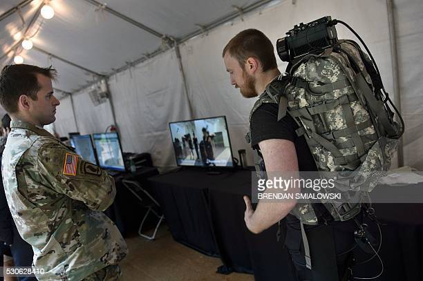An exhibitor speaks about an under suit that helps people on long marches reduce fatigue and avoid injuries at the Defense Advanced Research Projects...