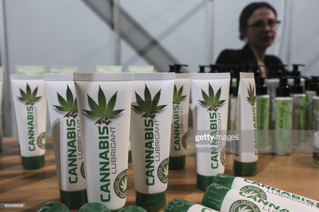 An exhibitor waits for customers beside a display of products made from cannabis, including 'Cannabis Lubricant' at the 1st International Cannabis Expo at the Faliro Sports Pavilion in Athens, Greece, on Friday, Jan. 12, 2018. The purpose of the event is to inform the public about all the products and innovations that exist in the world of cannabis and the latest achievements in the medical, pharmaceutical and industrial use of cannabis. Photographer: Yorgos Karahalis/Bloomberg via Getty Images