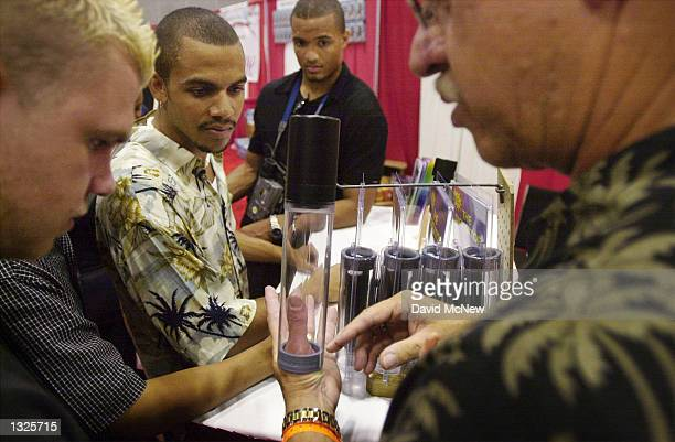 An exhibtor demonstrates how to use one of his products at the fifth annual Erotica LA adult entertainment trade show July 14 2001 in Los Angeles CA...