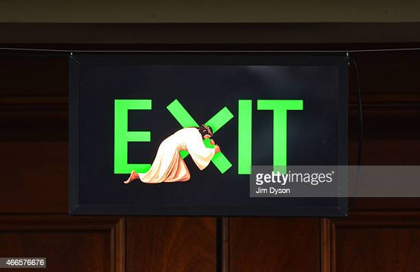 An exit sign in St Marylebone Parish Church shows Jesus carrying a cross as part of the 'Stations of the Cross' exhibition on March 16 2015 in London...