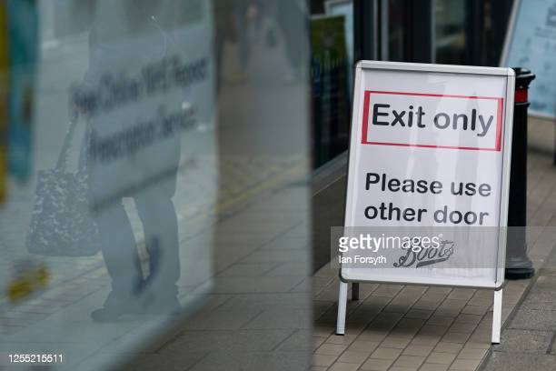 An exit sign is placed outside a Boots pharmacy on July 09 2020 in York United Kingdom Many UK businesses are announcing job losses due to the...