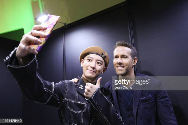 An EXO member and Ryan Reynolds attend the world premiere of Netflix's '6 Underground' at Dongdaemun Design Plaza on December 02 2019 in Seoul South...