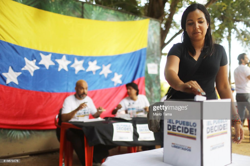 An expatriate Venezuelan casts her ballot during an unofficial referendum, or plebiscite, held by Venezuela's opposition against Venezuela's President Nicolas Maduro's government on July 16, 2017 in Rio de Janeiro, Brazil. Voting was conducted across 2,000 polling centers in Venezuela and in more than 80 countries around the world amidst a severe crisis in Venezuela.