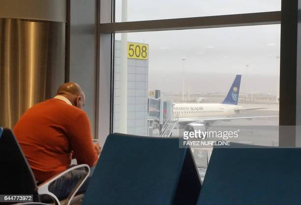 An expatriate working and living in the Saudi capital Riyadh waits for his flight at the King Khalid International airport on February 16 2017...