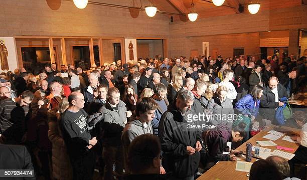 An expected crowd of 600 turned into nearly 1000 at this Republican presidential caucus site February 1 2016 in West Des Moines Iowa Democratic and...