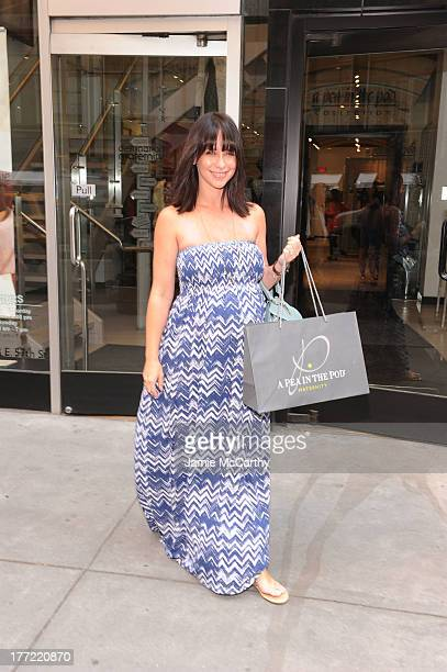 An expecting Jennifer Love Hewitt bumps up her style at Destination Maternity's New York Flagship store on August 21 2013 in New York City