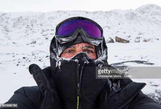 An expedition member's face is covered in ice during a ski traverse of Akshayuk Pass in Auyuittuq National Park on April 13 2017 on Baffin Island...