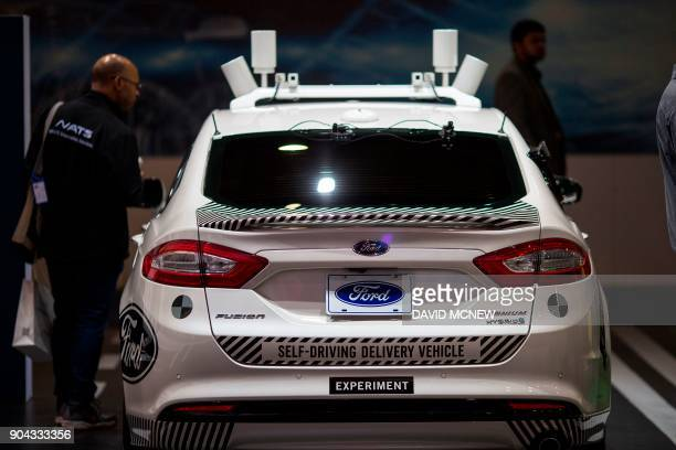An experimental Ford Fusion selfdriving delivery car is displayed at CES in Las Vegas Nevada January 12 2018 / AFP PHOTO / DAVID MCNEW