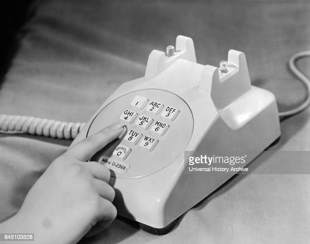 An experimental model of a push button telephone being developed at Bell Telephone Laboratories is shown as it would be used The pushbutton telephone...
