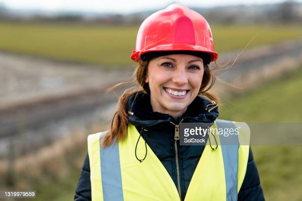 an expert at her job - jacket stock pictures, royalty-free photos & images