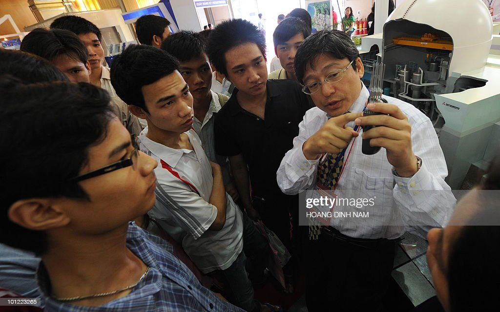 An expert from Japan's Mitshubishi group introduces features of his company's nuclear reactor at an exhibition on nuclear power being held in Hanoi on May 28, 2010. Vietnam plans to build its first nuclear power stations which should be operational from 2020. AFP PHOTO/HOANG DINH Nam