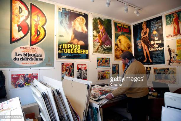 An expert on old posters Frederic Lozada looks at a poster of a movie with French actress Brigitte Bardot during the exhibition The Bardot years...