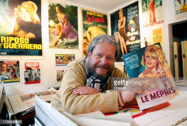 An expert on old posters Frederic Lozada shows a poster of the movie Le Mepris with French actress Brigitte Bardot during the exhibition The Bardot...