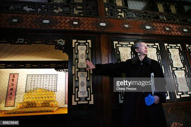 An expert shows reporters the interior decorations of the Juanqin Studio after its renovation in the Forbidden City on November 10 2008 in Beijing...