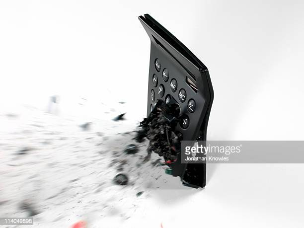 An exploding calculator on white background