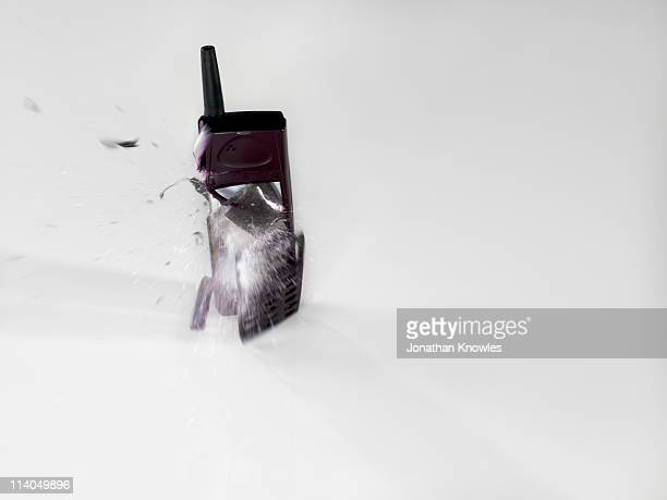 An exploding mobile phone on a white background