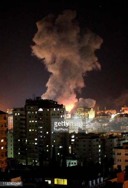 An explosion and smoke as an Israeli air strike hits Gaza City on March 25 2019