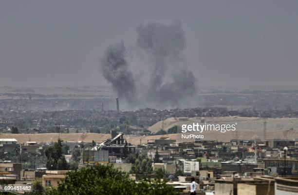 An explosion close to the leaning minaret of the AlNouri Mosque that was destroyed later the same day Mosul Iraq 21 June 2017