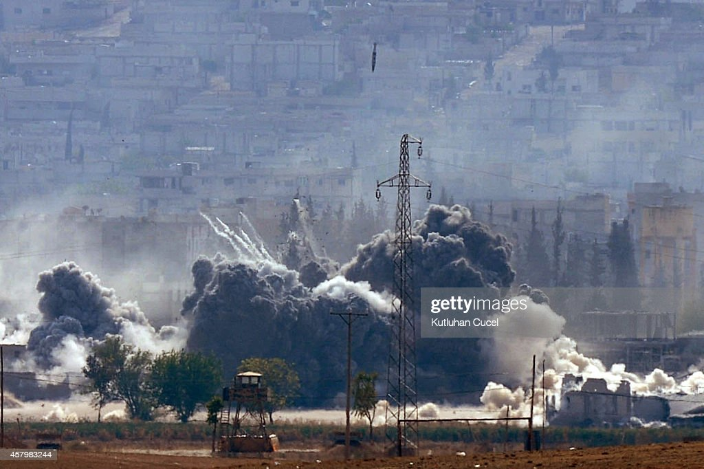 An explosion following an air-strike in the Syrian town of Kobani from near the Mursitpinar border crossing on the Turkish-Syrian border in the southeastern town of Suruc in Sanliurfa province October 28, 2014. It has been reported that 150 Iraqi peshmerga from Iraq's northern Kurdistan region, armed with American weapons, are expected to arrive in Turkey later today following authorization of their deployment last week. The Iraqi peshmerga fighters will fly into Turkey and travel by land across the Syrian border to provide logistical and artillery support to their Syrian counterparts, but will not be involved in frontline combat.
