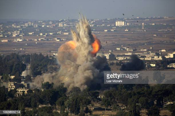 An explosion in Quneitra on the Syrian side of the IsraeliSyrian border is seen from the Israeli Golan Heights on July 22 2018 in Quneitra Syria A...