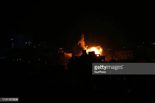 An explosion is pictured among buildings during an Israeli airstike on Gaza City on May 4 2019 Gaza militants fired a barrage of rockets at Israel...