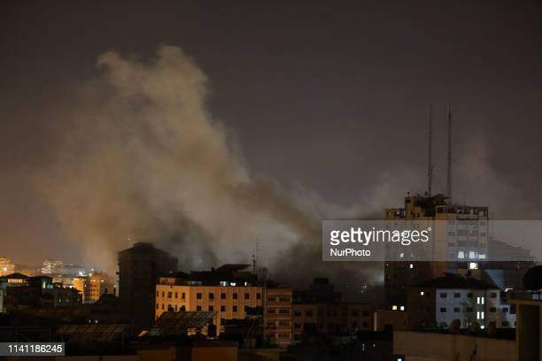 An explosion is pictured among buildings during an Israeli airstike on Gaza City on May5 2019 Gaza militants fired a barrage of rockets at Israel...