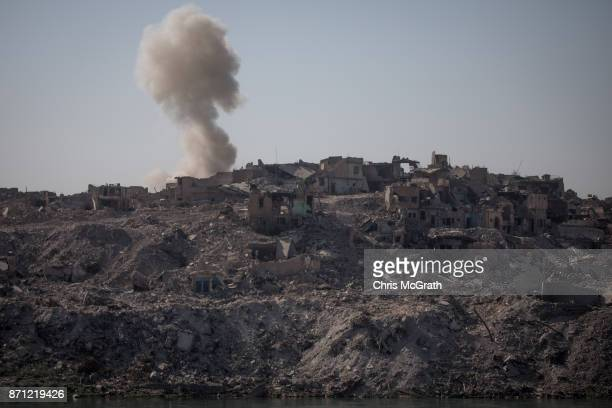 An explosion is seen in the destroyed Old City in West Mosul on November 4 2017 in Mosul Iraq Five months after Mosul Iraq's secondlargest city was...