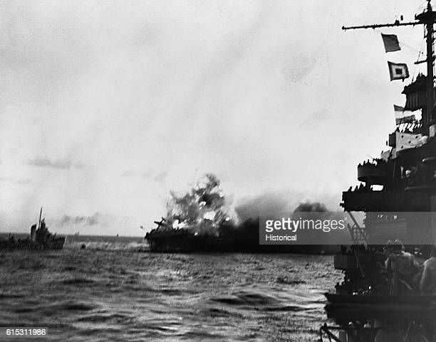 An explosion rocks the burning USS Lexington with a force that pitches a plane from her deck