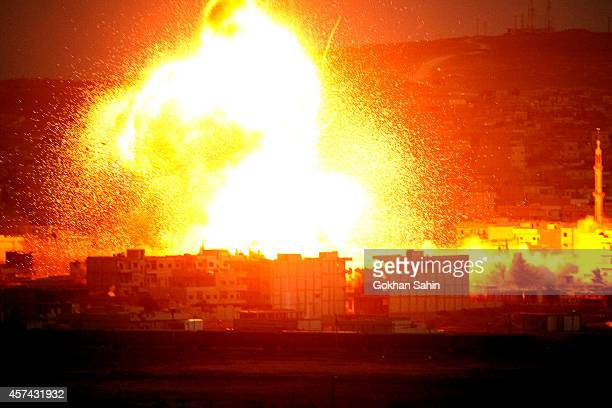 An explosion rocks the Syrian city of Kobani during an airstrike by the USled coalition during fighting between Syrian Kurds and the militants of...