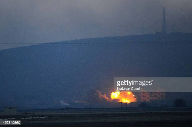 An explosion rocks the Syrian town of Kobani after an airstrike as seen from the Mursitpinar crossing on the TurkishSyrian border in the southeastern...