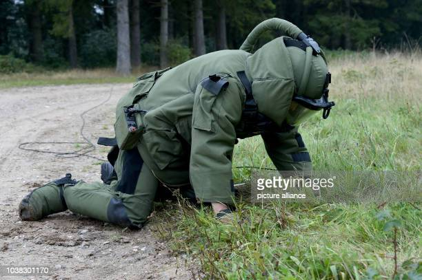 An explosive ordnance disposal  officer of the German Air Force checks a suspicious location during a military exercise in Eckernfoerde Germany 23...