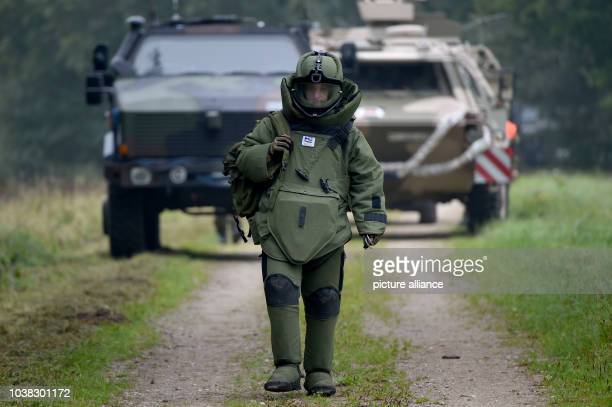 An explosive ordnance disposal  officer of the German Air Force walks to the operation area in Eckernfoerde Germany 23 September 2015 Around 3600...