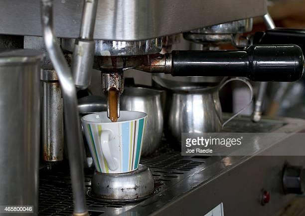 An expresso coffee pours into a cup for a customer at the Los Pinarenos Fruteria on March 10 2015 in Miami Florida A panel of governmentappointed...